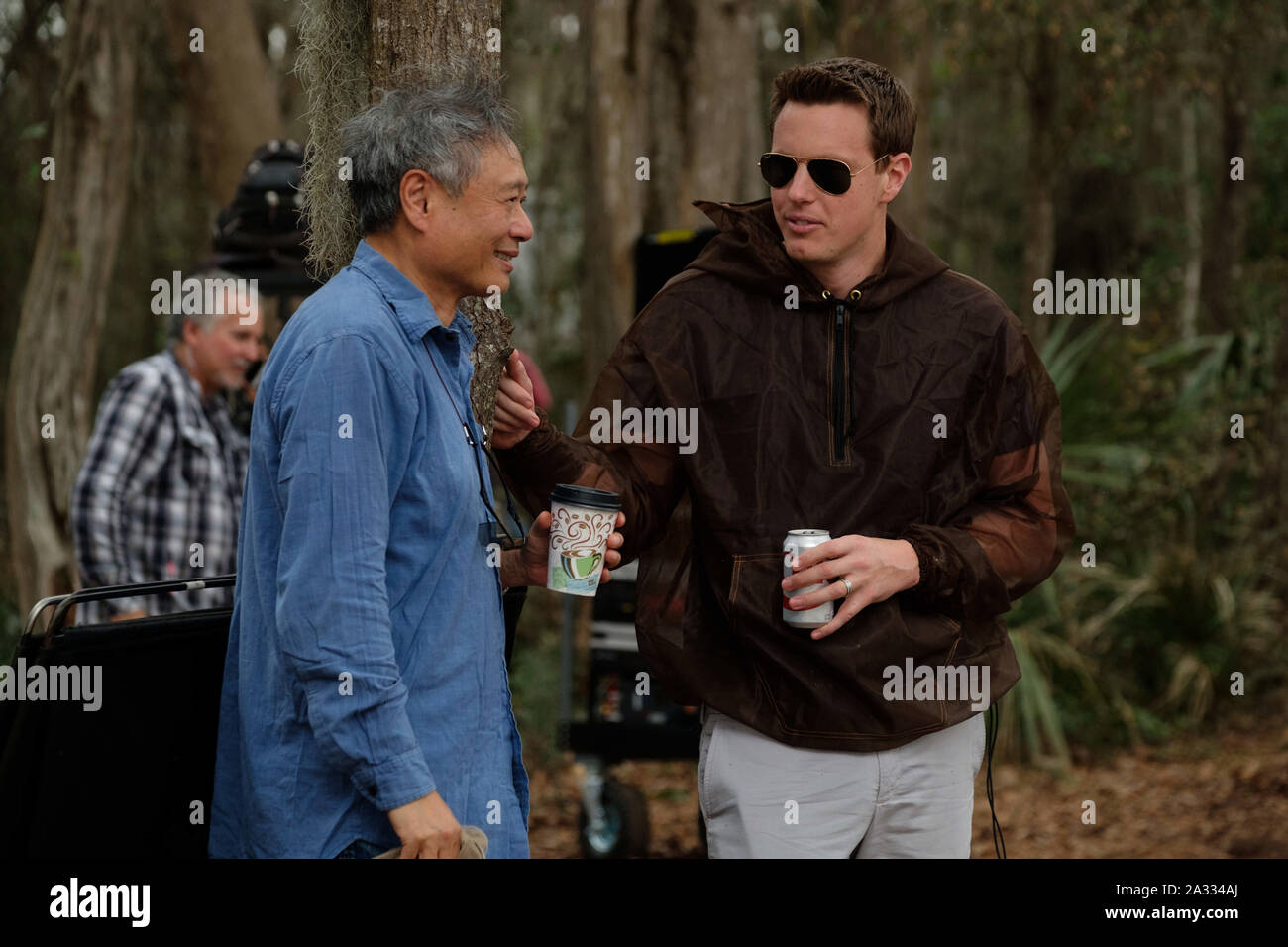 Director Ang Lee and David Ellison on the set of Gemini Man from Paramount Pictures, Skydance and Jerry Bruckheimer Films (2019). Photo Credit:  Ben Rothstein/Paramount Pictures/The Hollywood Archive Stock Photo