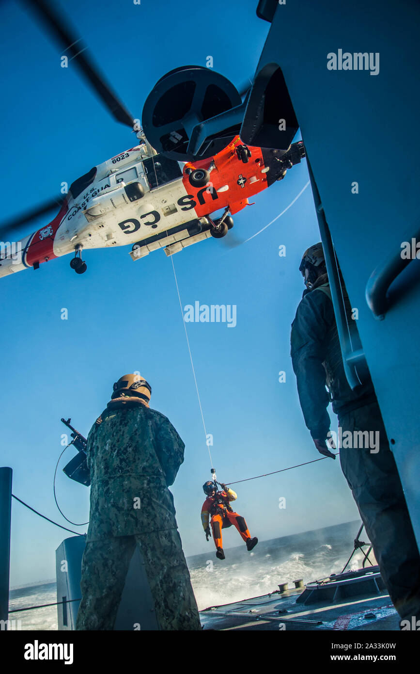 191002-N-NT795-411 SAN DIEGO (Oct. 2, 2019) Sailors assigned to Coastal Riverine Squadron 3 and Coast Guardsmen from U.S. Coast Guard Sector San Diego, conduct a joint medical evacuation exercise aboard a Mark VI patrol boat as part of unit level training provided by Coastal Riverine Group 1 Training and Evaluation Unit. The Coastal Riverine Force is a core Navy capability that provides port and harbor security, high value asset security, and maritime security operation in the coastal and inland waterways. (U.S. Navy photo by Chief Boatswain's Mate Nelson Doromal Jr) Stock Photo