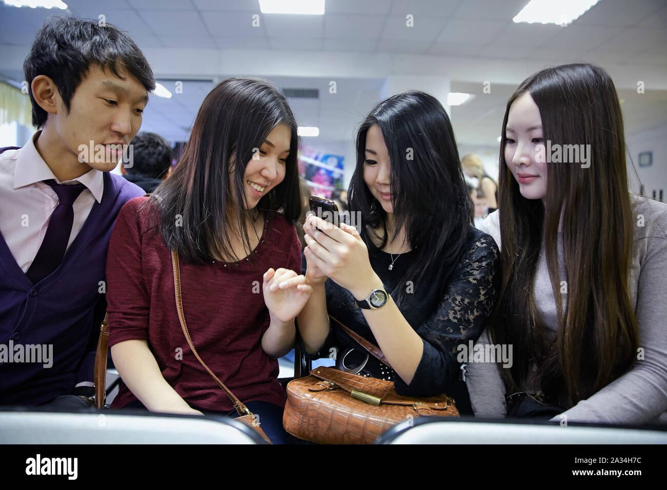 Russia Yakutsk students with there mobile phones 1-02-2013 photo: Jaco Klamer Stock Photo