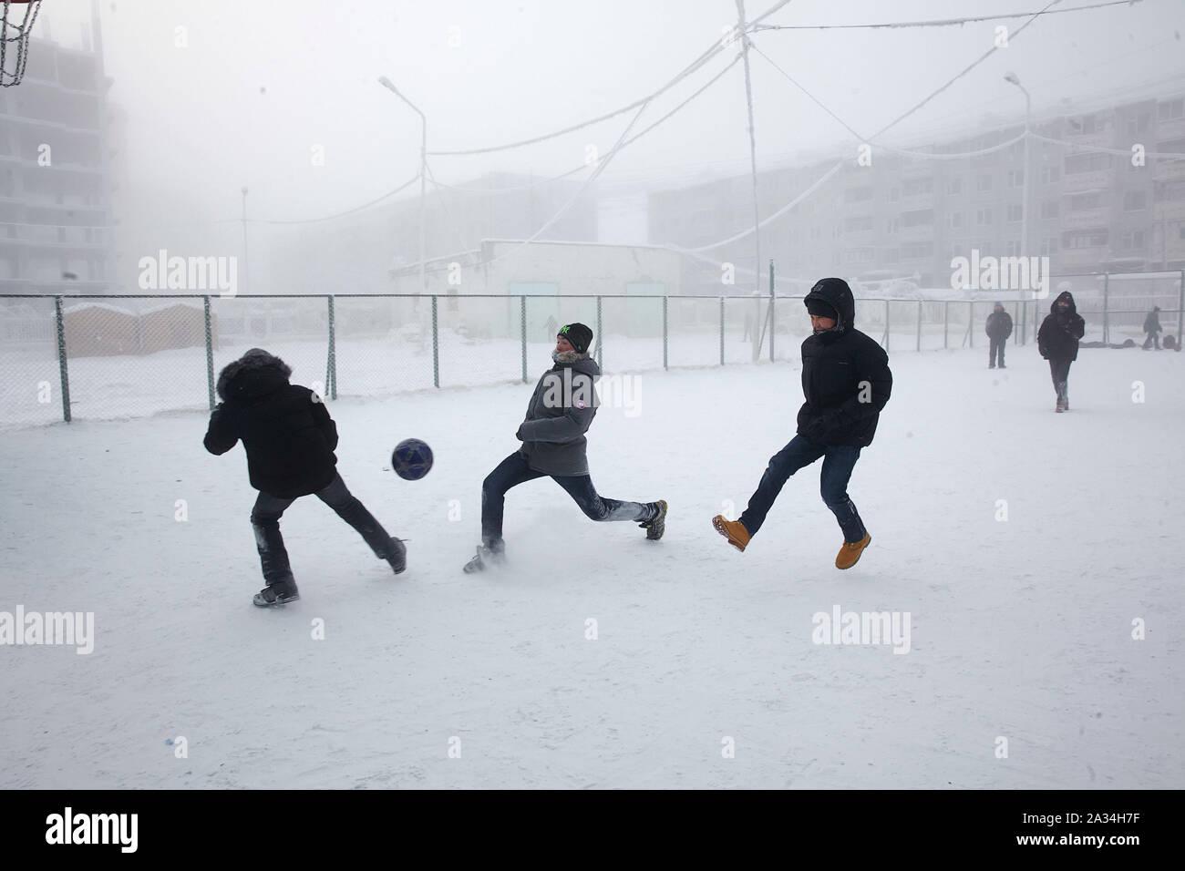Russia Yakutsk Young people playing footbal -42 degrees Celcius 2-02-2013 photo: Jaco Klamer Stock Photo