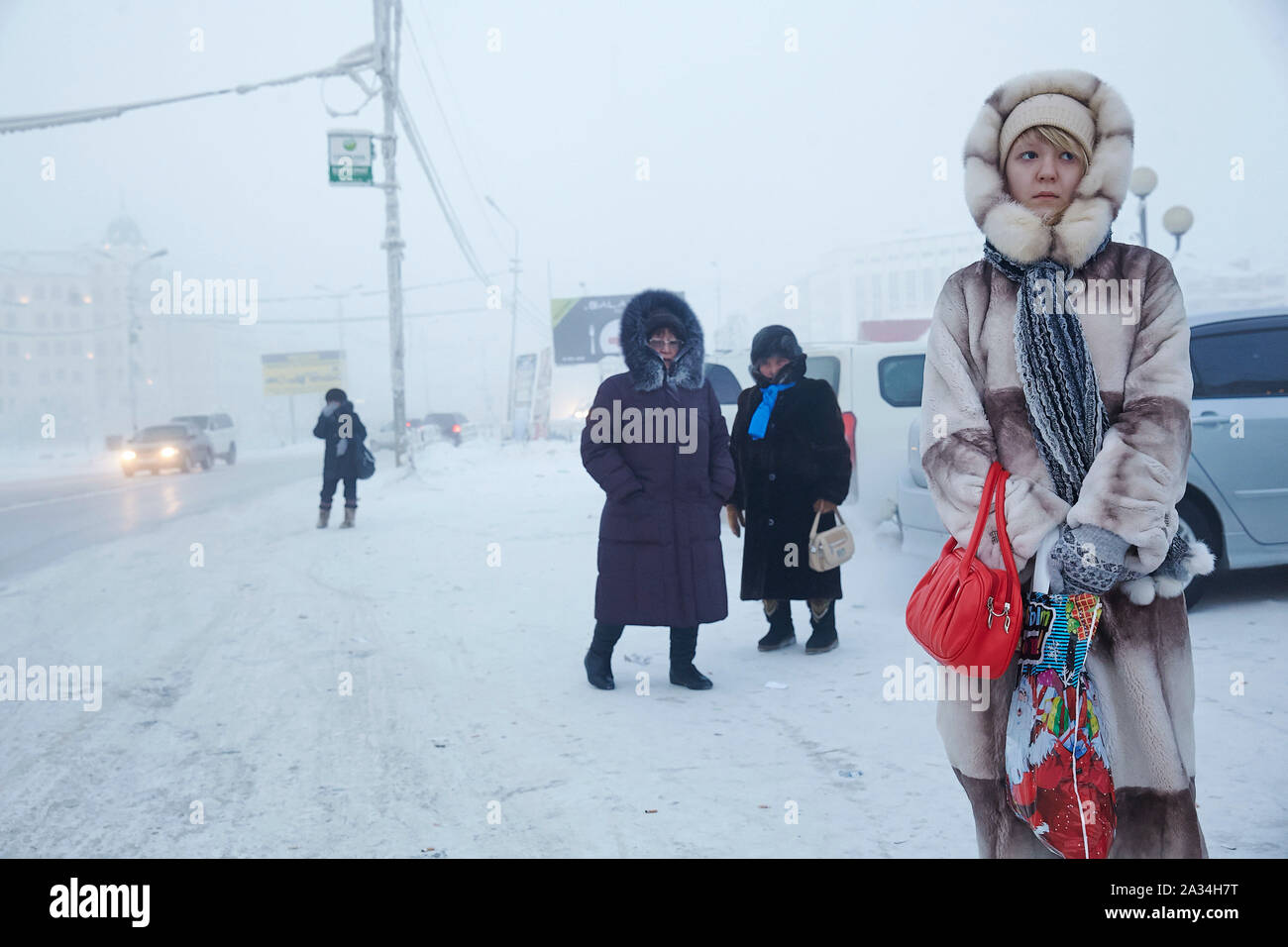 Russia Yakutsk Girl with mobile phone in the bus 3-02-2013 photo: Jaco Klamer Stock Photo