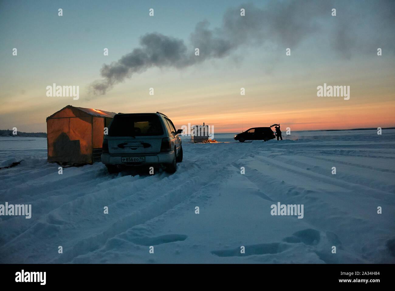 Russia Yakutsk Lena  Simeon Jegorov (53)  fishing on Ice with car and small house -45 degrees celcius  3-02-2013 photo: Jaco Klamer Stock Photo