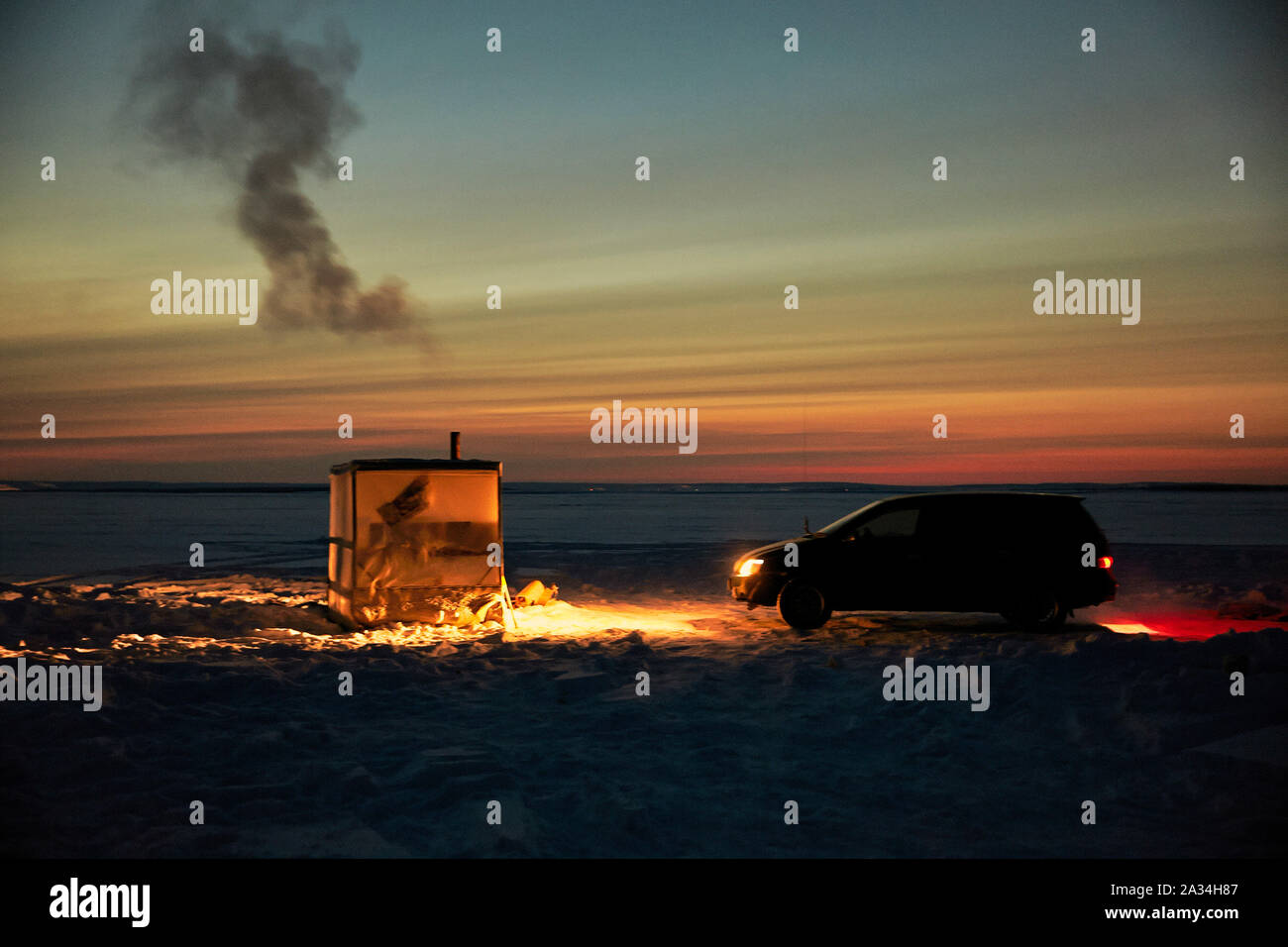 Russia Yakutsk Lena  Simeon Jegorov (53)  fishing on Ice with car and small house -45 degrees celcius  3-02-2013 photo: Jaco Klamer Stock Photo