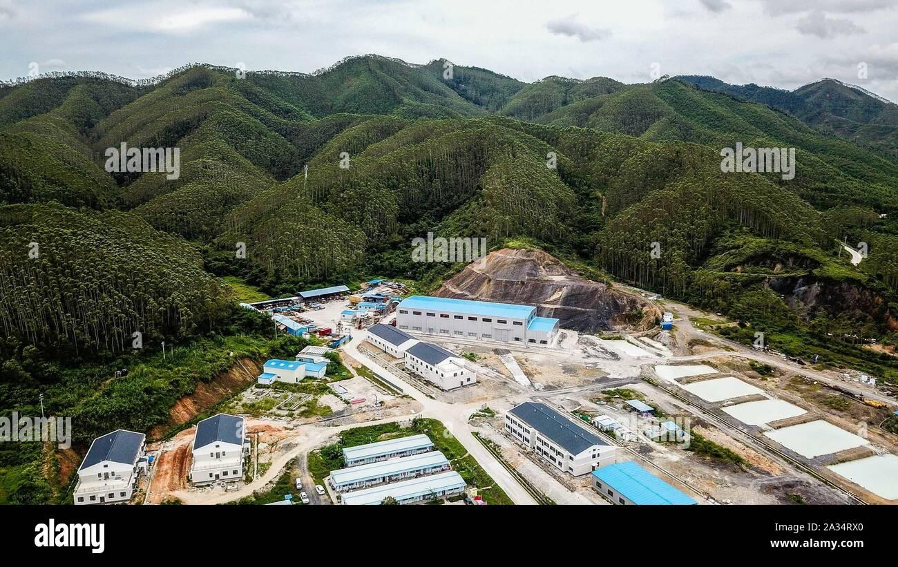 (191005) -- GUANGZHOU, Oct. 5, 2019 (Xinhua) -- Aerial photo taken on June 23, 2019 shows the construction site of the Jiangmen Underground Neutrino Observatory (JUNO) in Jiangmen, south China's Guangdong Province. (Xinhua/Liu Dawei) Stock Photo