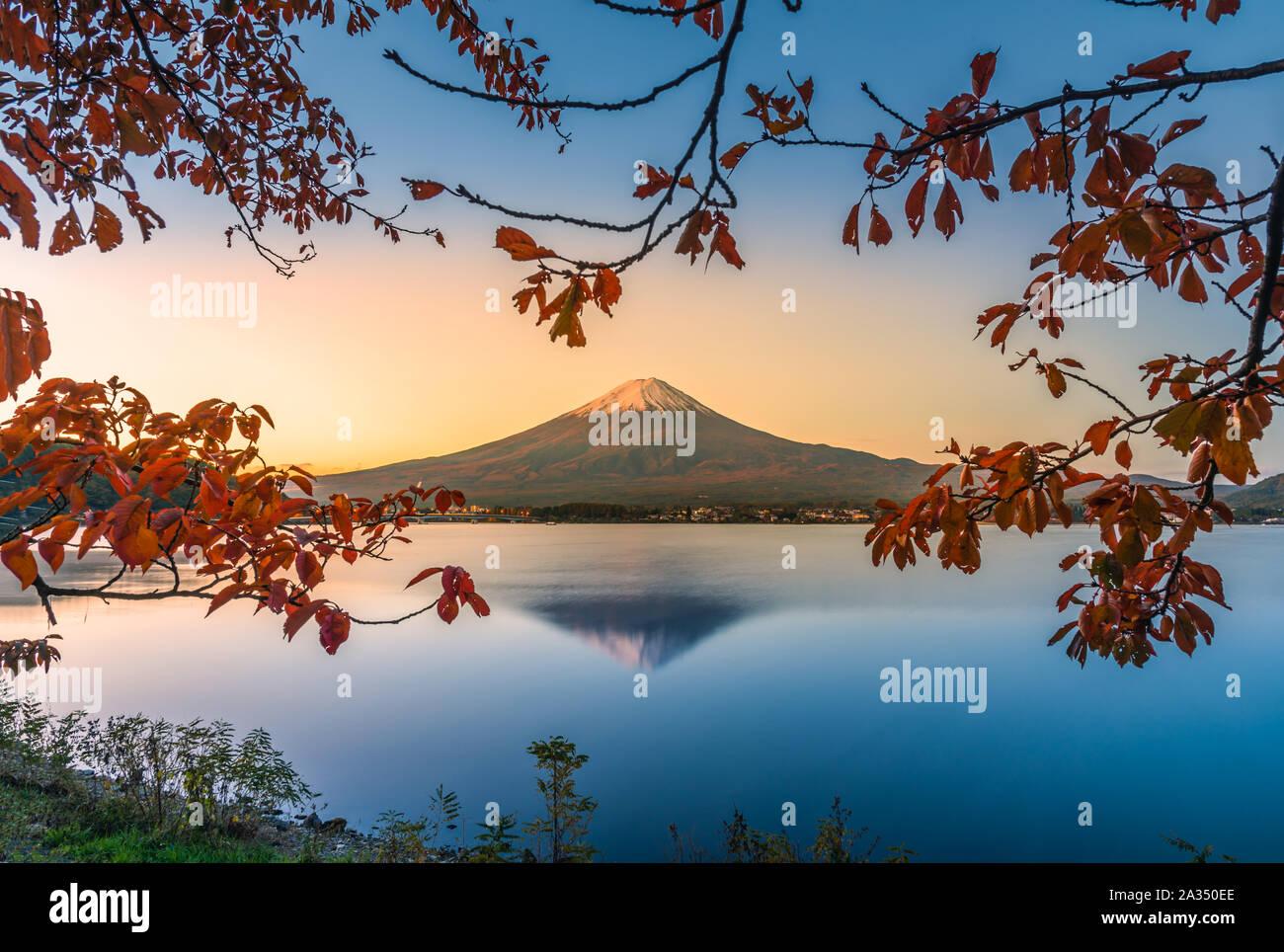 Landscape image of Mt. Fuji over Lake Kawaguchiko with autumn foliage at sunrise in Fujikawaguchiko, Japan. Stock Photo
