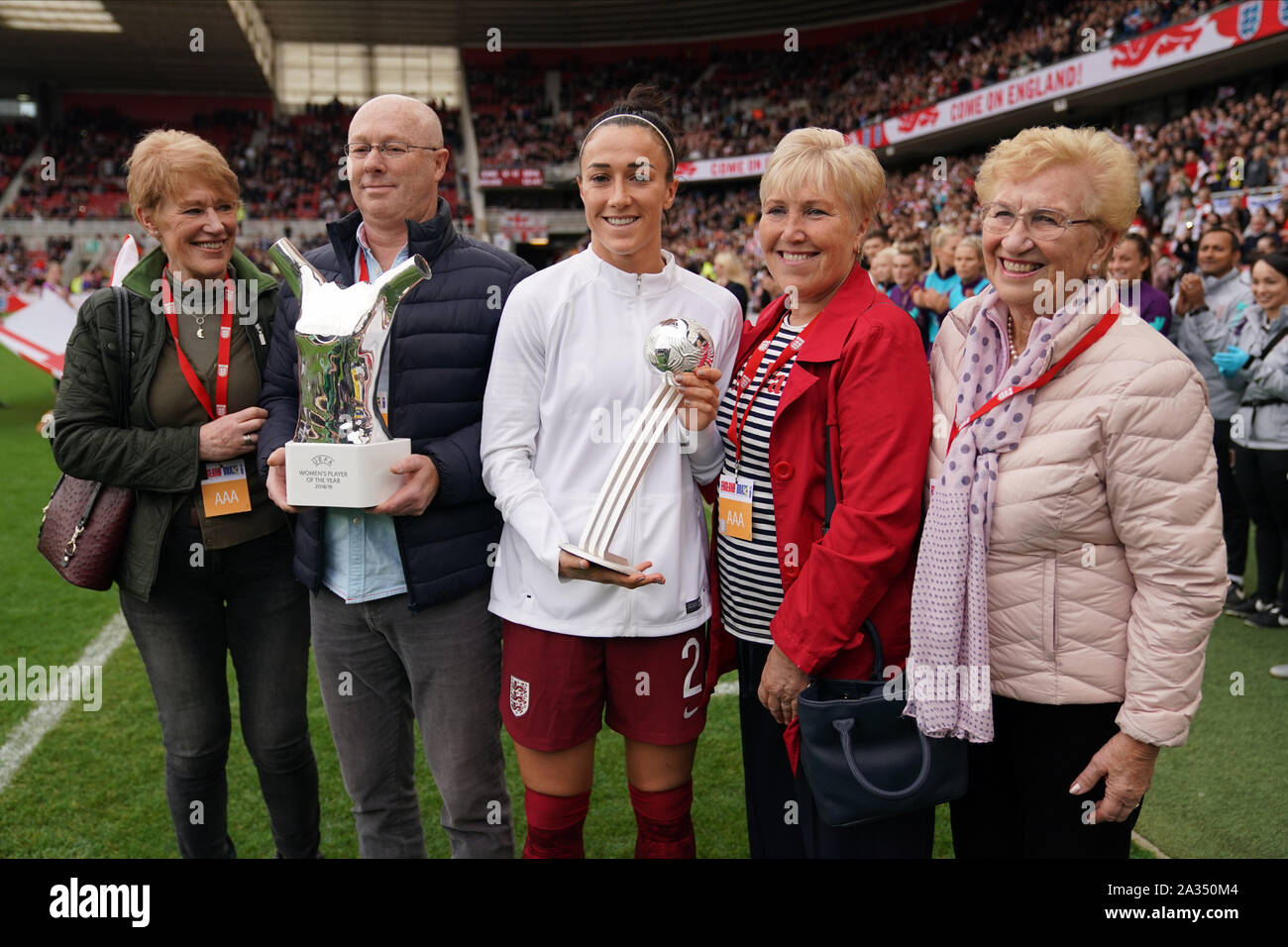 Middlesbrough, UK. 5th Oct, 2019. Lucy Bronze of England with her family receives an honor for her achievments at the Fifa and UEFA awards during the International Women's friendly between England Women and Brazil Women at Riverside Stadium, on October 05, 2019 in Middlesbrough, England. Credit: SPP Sport Press Photo. /Alamy Live News Stock Photo