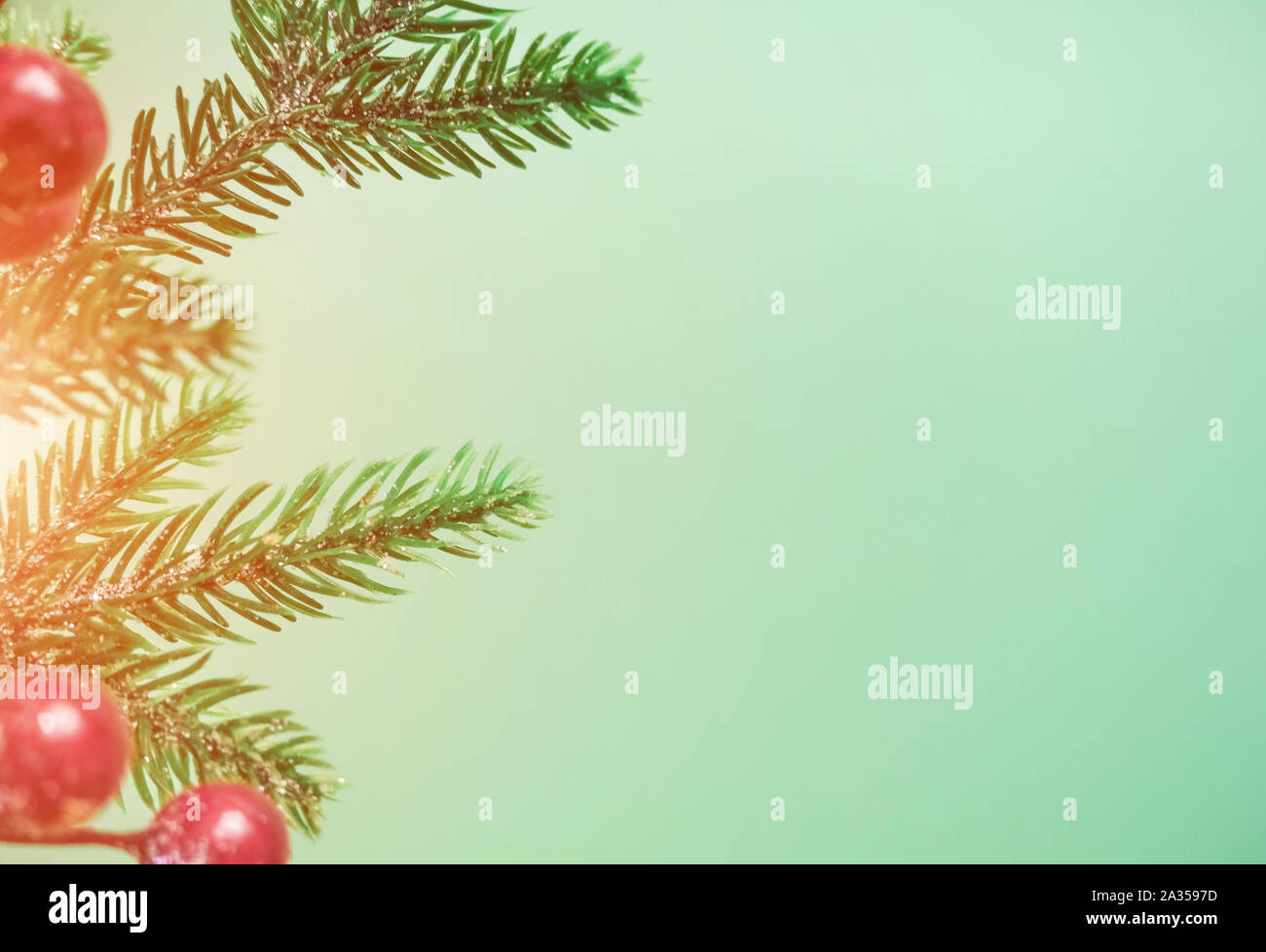 Christmas Decorations With Red Berries And Fir Branches On A Beautiful Mint Background Stock Photo Alamy