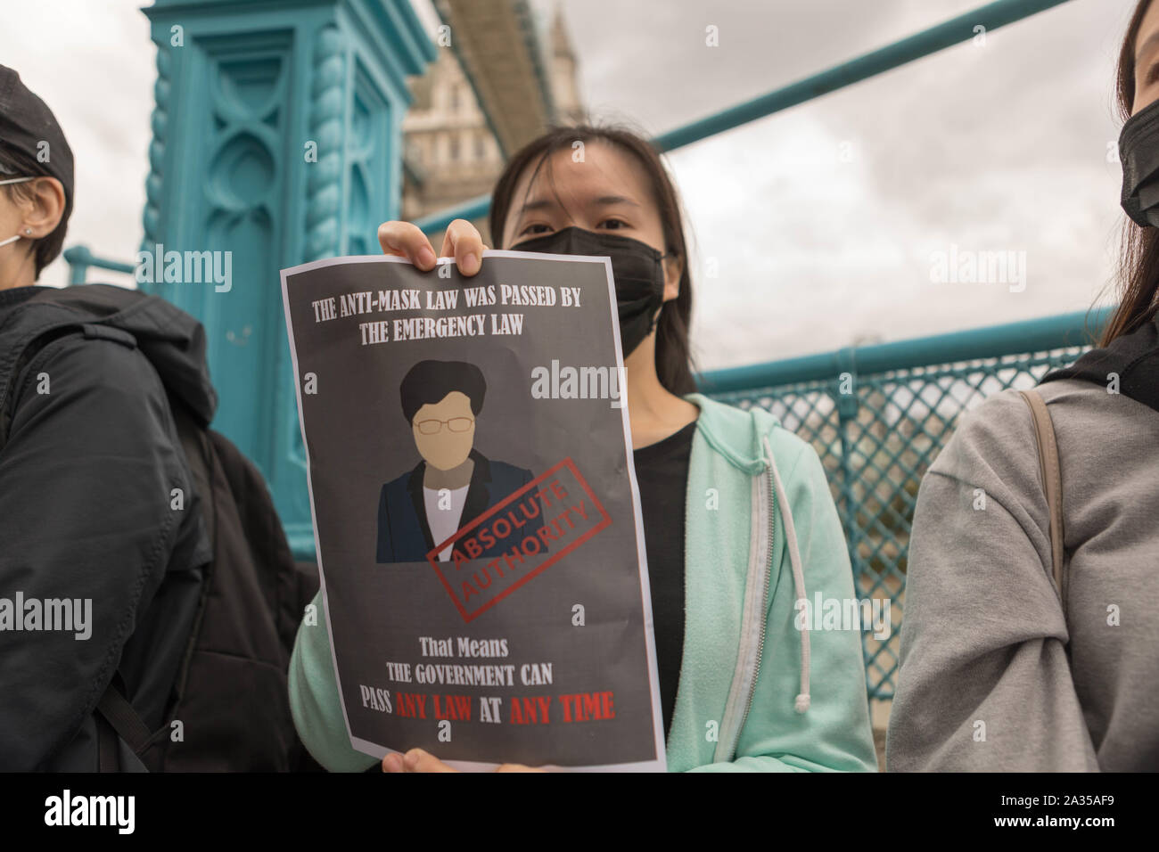 London, UK. 5th Oct, 2019. Chinese artist Badiucao and supporters join hands in a human chain, a showing of solidarity with protesters in Hong Kong. The Lennon Wall flag, symbolising Hong Kongs fight for freedom is also symbolically raised. Penelope Barritt/Alamy Live News Stock Photo
