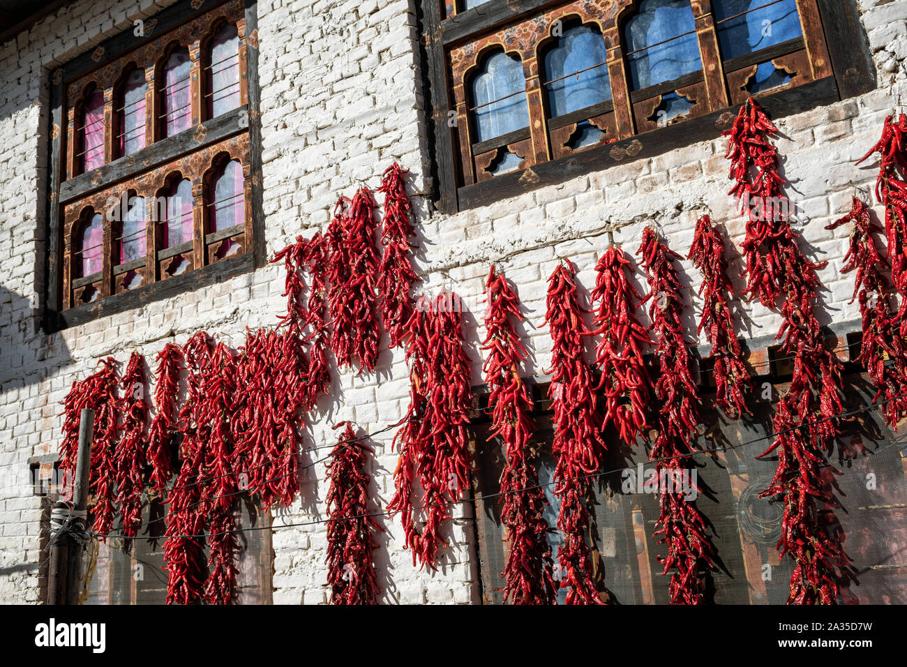 Red hot chilli peppers drying in the sun in Paro, Bhutan Stock Photo