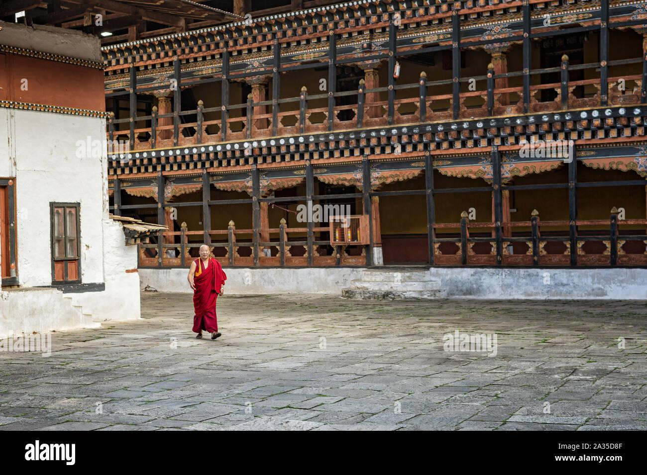 Monk in the courtyard of the Paro dzong (Rinpung Dzong), Bhutan Stock Photo