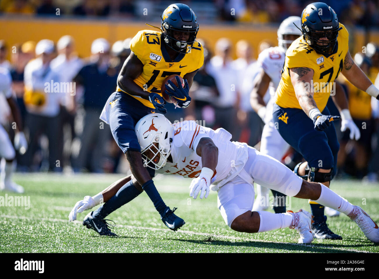 West Virginia Mountaineers wide receiver Sam James (13) is tackled by Texas Longhorns linebacker Juwan Mitchell (6) during the NCAA college football game between the Texas Longhorns and the West Virginia Mountaineers on Saturday October 5, 2019 at Milan Puskar Stadium in Morgantown, West Virginia. Jacob Kupferman/CSM Stock Photo