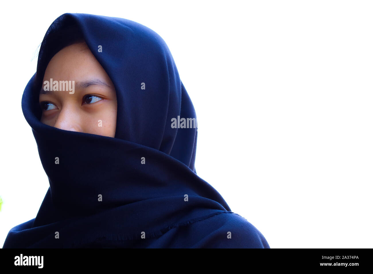 a photo of a Muslim woman in a veil Stock Photo