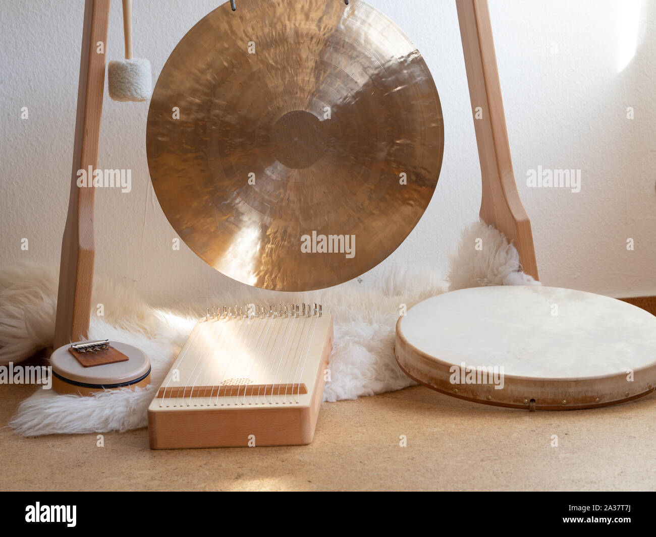 Sound healing therapy set up with gong, sansula, shamanic drum and monochord Stock Photo