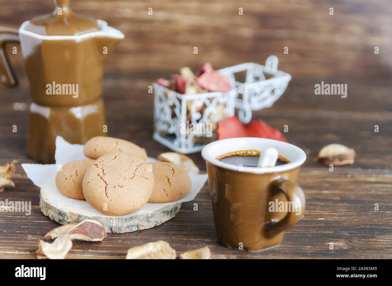 Cup Of Black Coffee And Almond Cookies Coffee Kettle Decorated With Fall Leaves On Wooden Table Delicious Beverage For Cold Autumn Season Good Mor Stock Photo Alamy
