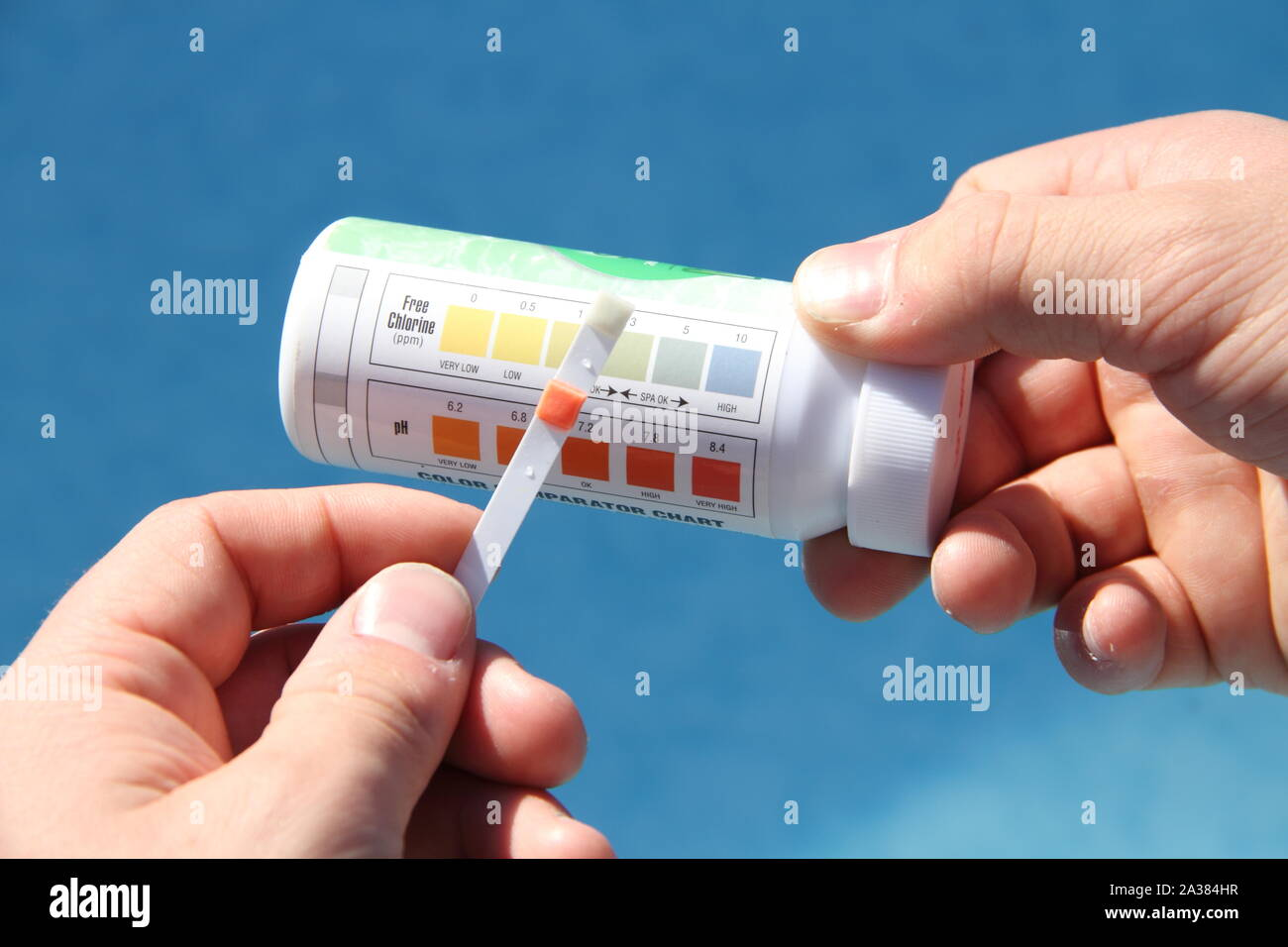 Test water in the pool for chlorine content Stock Photo