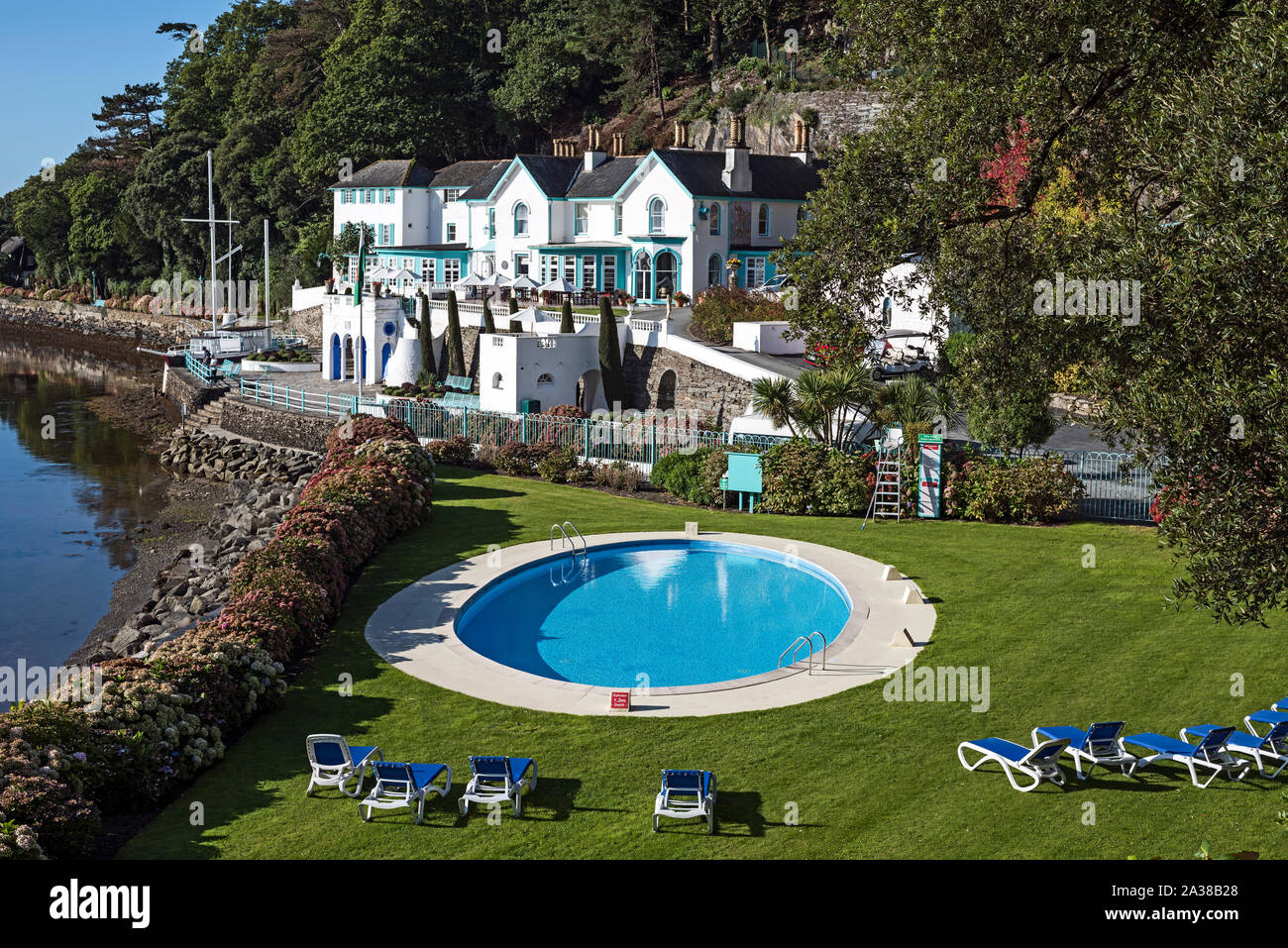 Colourful hotel building on the quay at the hillside village of Portmeirion, Wales, on the estuary of the River Dwyryd. Stock Photo