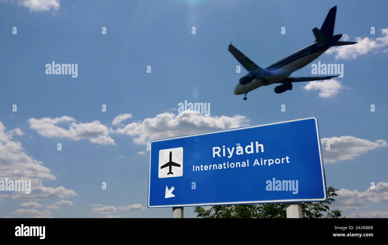 Airplane Silhouette Landing In Riyadh Saudi Arabia City Arrival With International Airport Direction Signboard And Blue Sky In Background Travel T Stock Photo Alamy