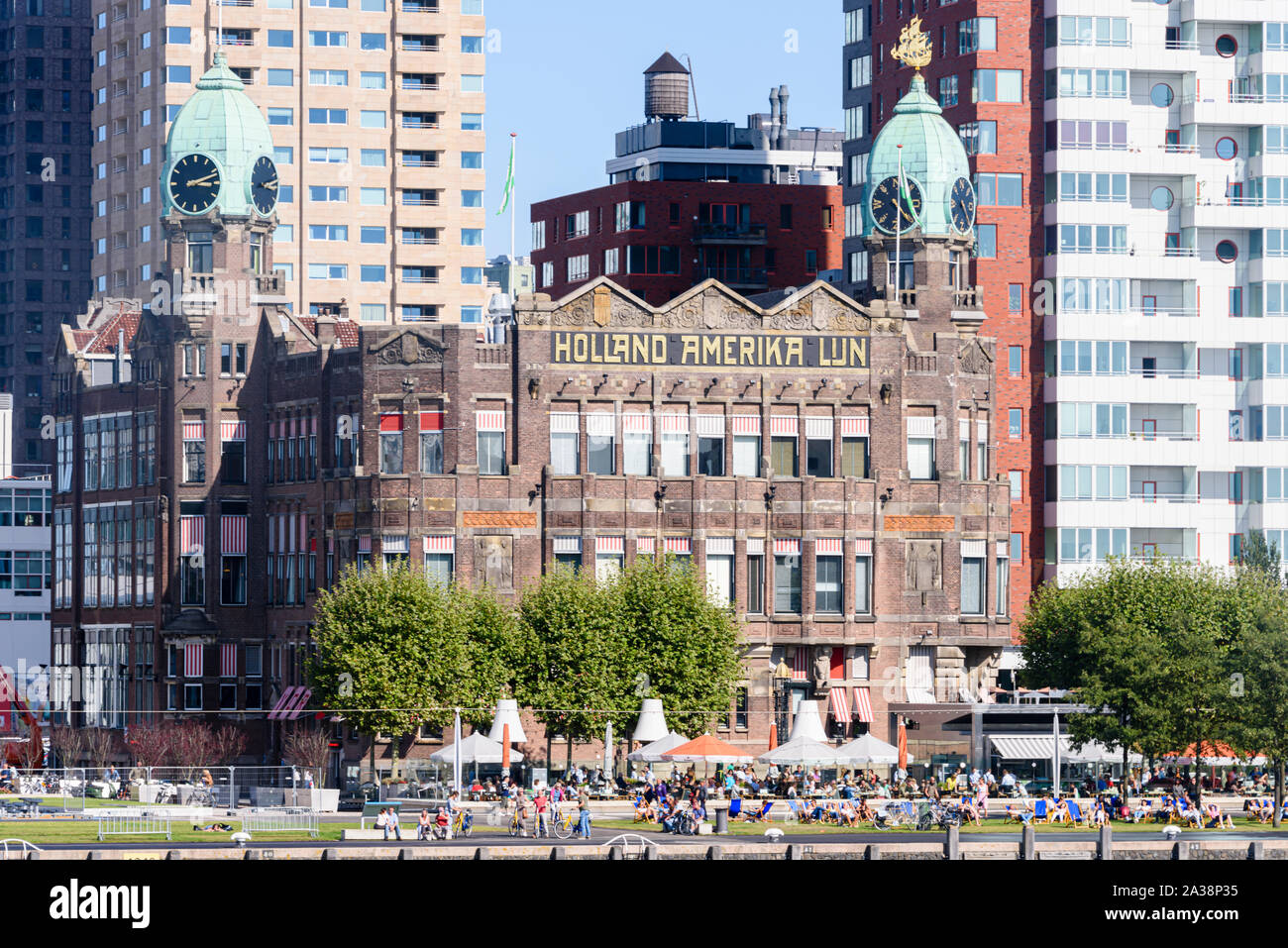 The old Holland Amerika Lijn (Holland America Line) building, now Hotel New York, surrounded by modern office blocks, Rijnhaven, Rotterdam, Netherland Stock Photo