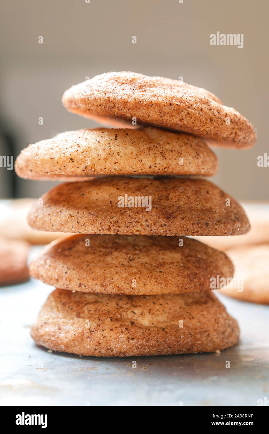 Snickerdoodles cookies (or sugar cookies) stacked on a baking tray. Vertical shot. Stock Photo