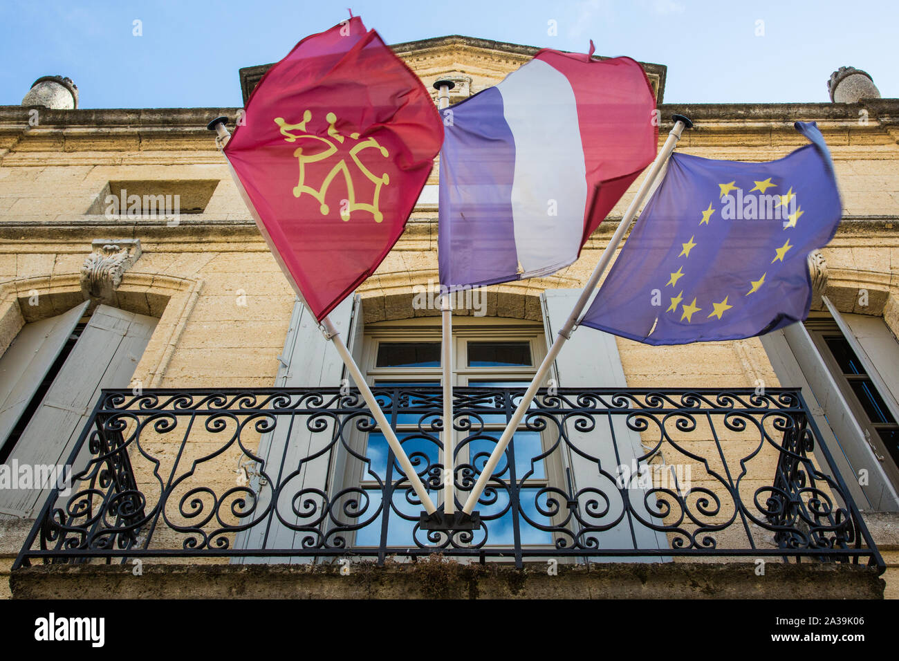 Saint-Quentin-la-Potèrie, France. 21 August, 2019. The flags of the Gard department, French Republic and European Union fly outside the town hall. Cre Stock Photo