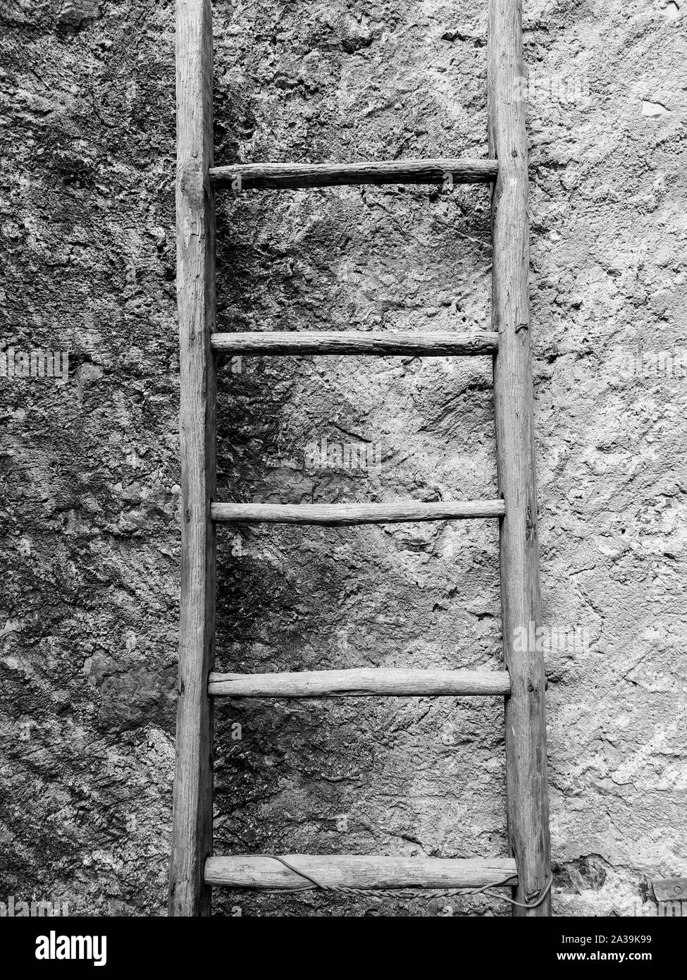 Ancient wood stepladder in black and white Stock Photo