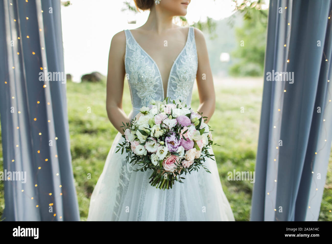 Bride Holding In Hands Small Wedding Bouquet In Pastel Colors