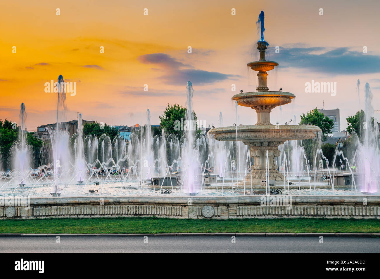 Fountains with sunset at Unirii Square in Bucharest, Romania Stock Photo