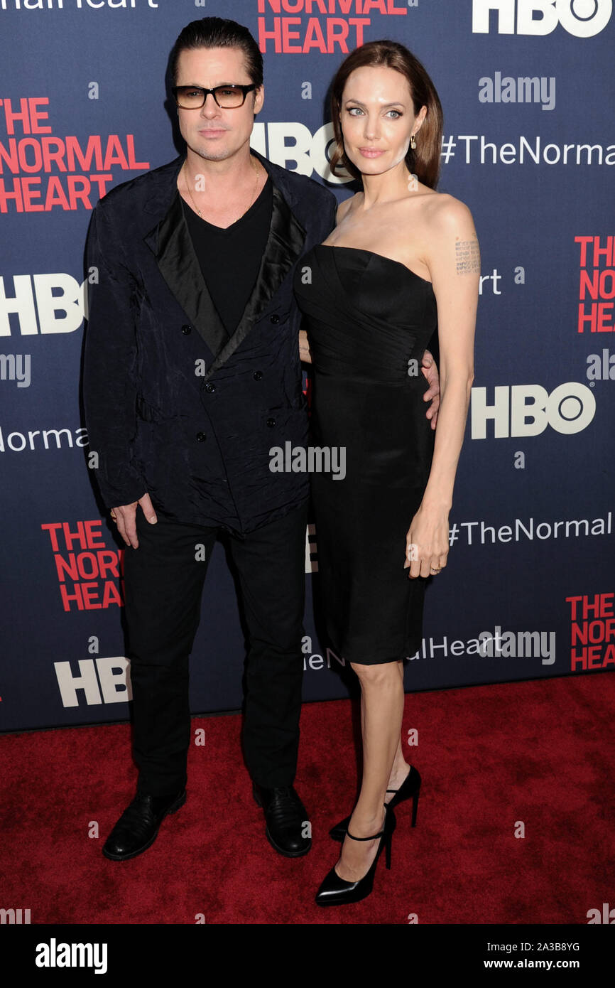 """(FILE) Angelina Jolie talks Brad Pitt divorce: """"I felt a deep and genuine sadness"""". MANHATTAN, NEW YORK CITY, NEW YORK, USA - MAY 12: Actors Brad Pitt (wearing Greg Lauren) and Angelina Jolie Pitt (wearing Saint Laurent dress and shoes) arrive at the New York Premiere of HBO's 'The Normal Heart' held at the Ziegfeld Theater on May 12, 2014 in Manhattan, New York City, New York, United States. ( Credit: Image Press Agency/Alamy Live News Stock Photo"""