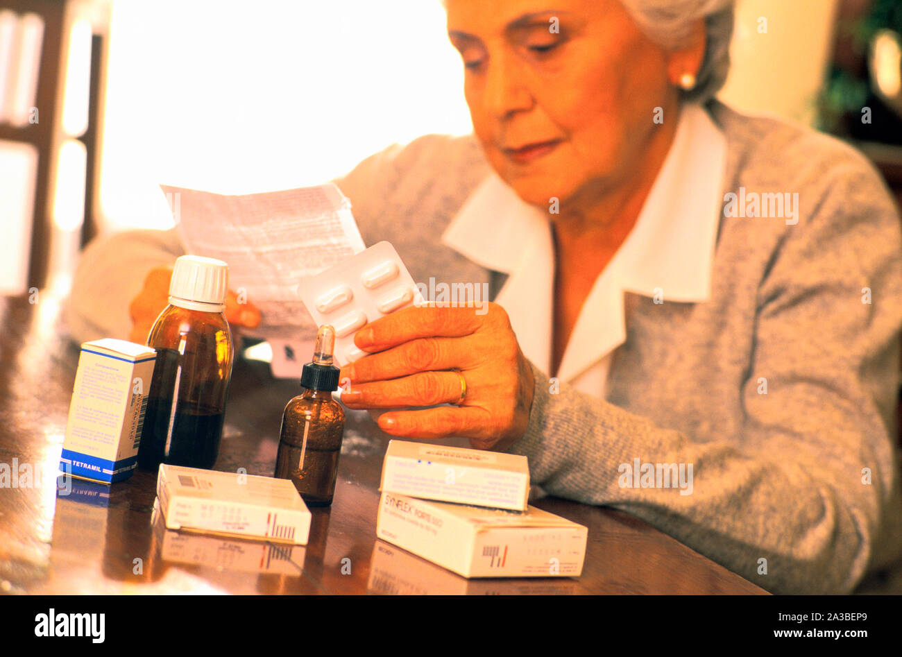 elderly woman, medicine, explanatory note Stock Photo