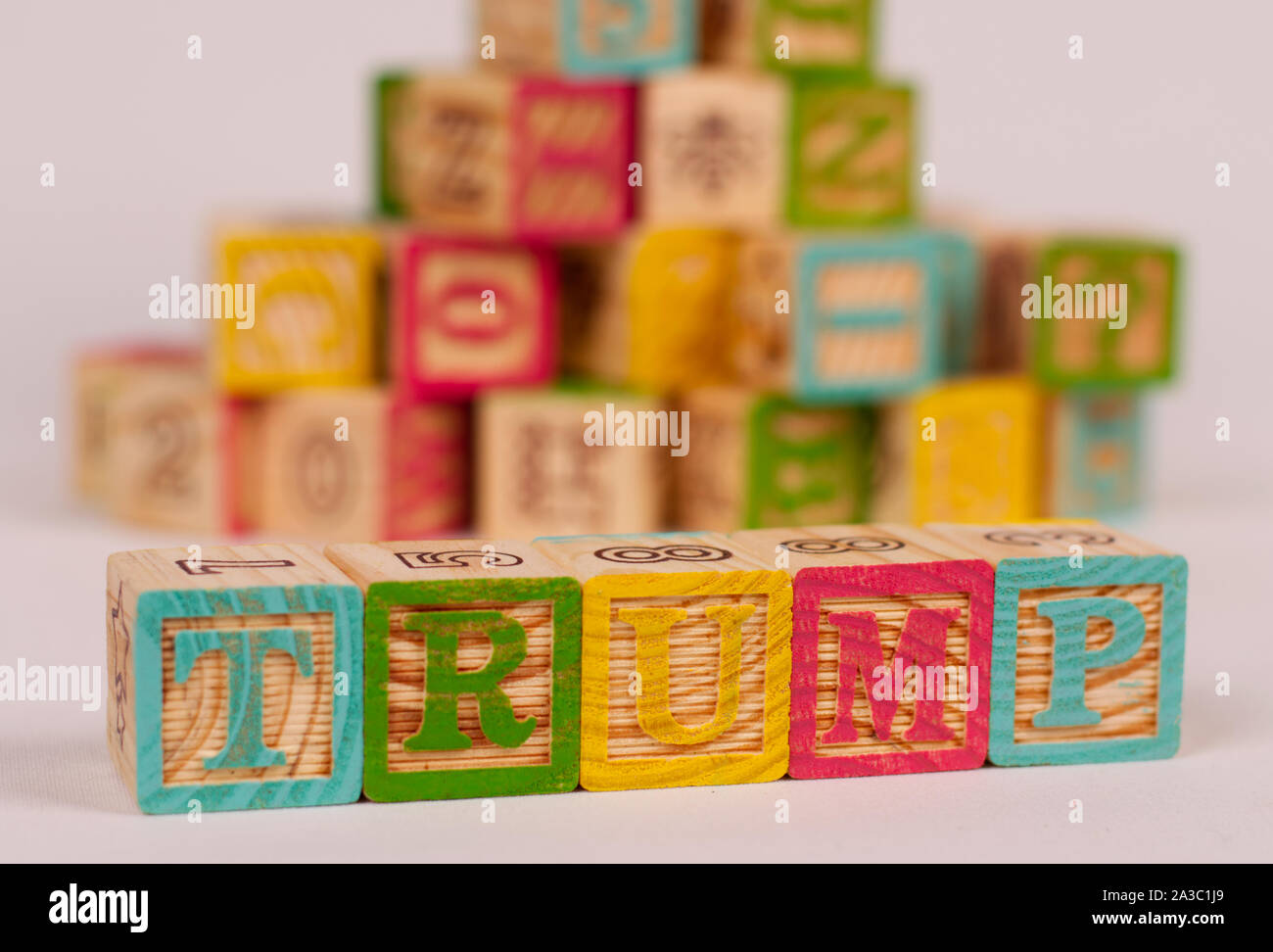 The name 'Trump' in wooden, coloured blocks. Donald Trump is the republican President of USA, known for fake news and impeachment by the democrats. Stock Photo