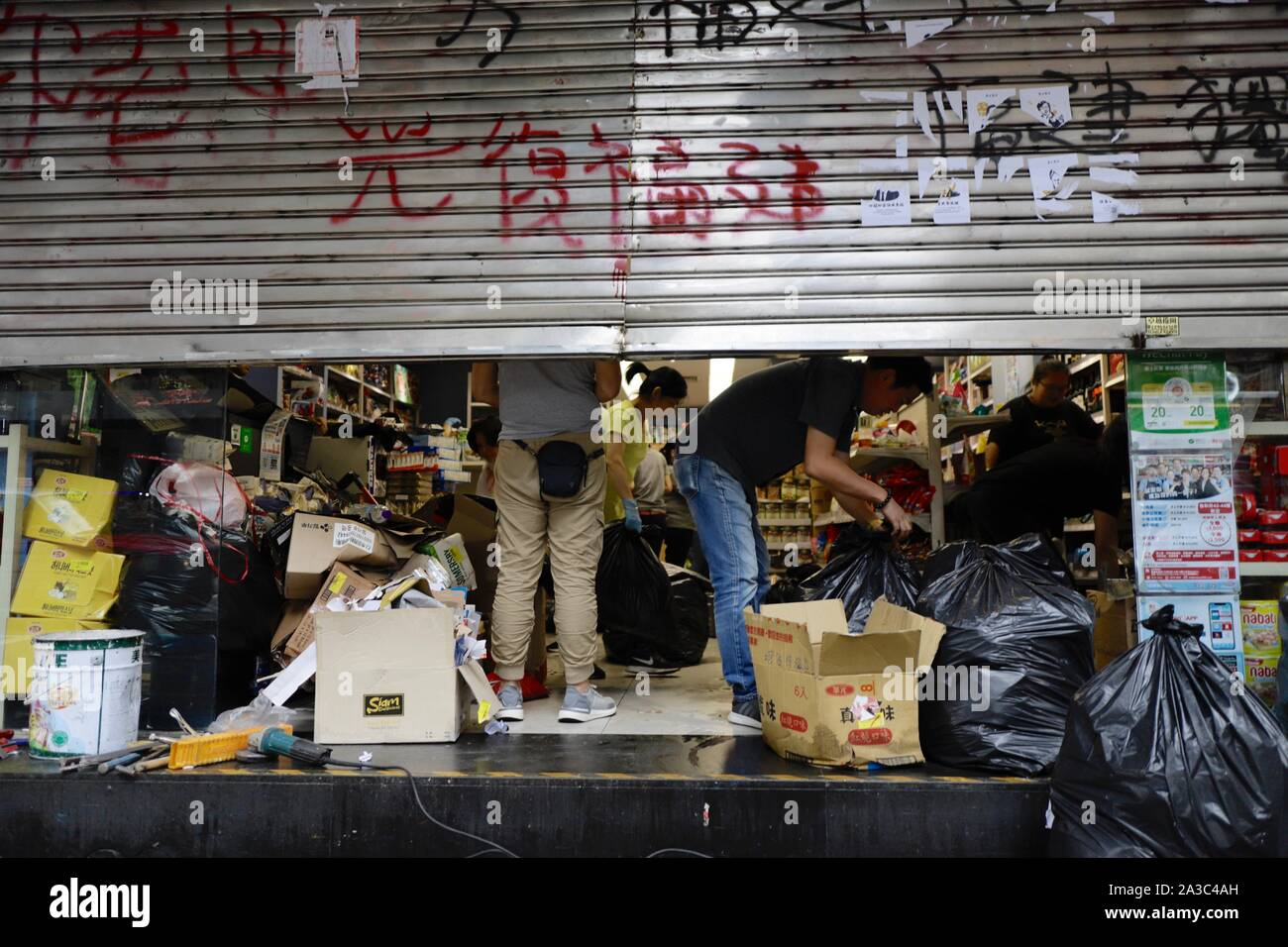 October 7, 2019, Hong Kong, CHINA: Workers clean up the mess inside the shop after the protest. Popular grocery store managed by Fukinese Capitalist Group ( a target of hate by HK pro-democracy protesters because of their Pro-Beijing position ) is being vandalized during last weekend's violent protest.Oct-7,2019 Hong Kong.ZUMA/Liau Chung-ren (Credit Image: © Liau Chung-ren/ZUMA Wire) Stock Photo