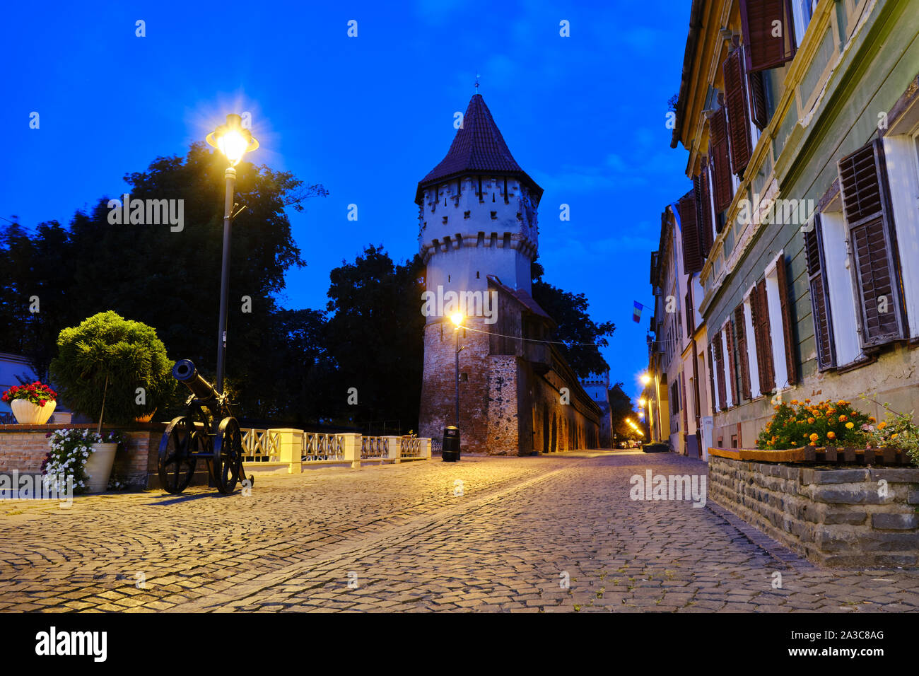 Cetatii street and Carpenters Tower (Turnul Dulgherilor), Sibiu, at blue hour, before sunrise. This brick-&-stone tower was constructed in the 14th ce Stock Photo