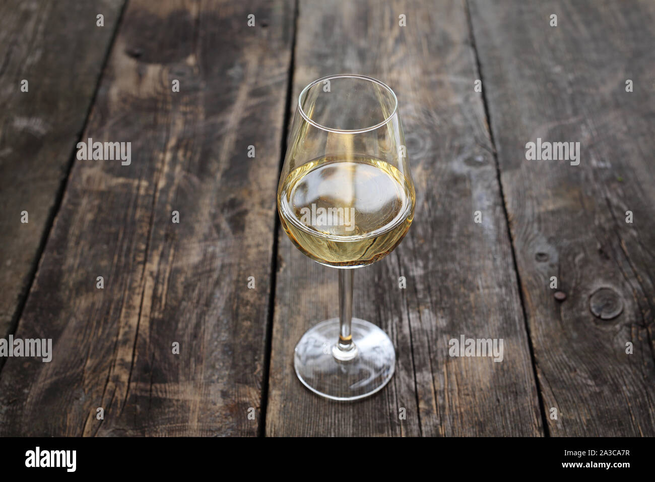 Glass of red wine on a wooden background Stock Photo
