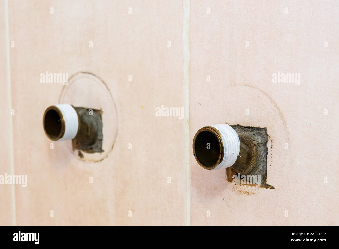 The plumber puts Teflon seam FUM tape on the thread before installing the faucet tap. Stock Photo