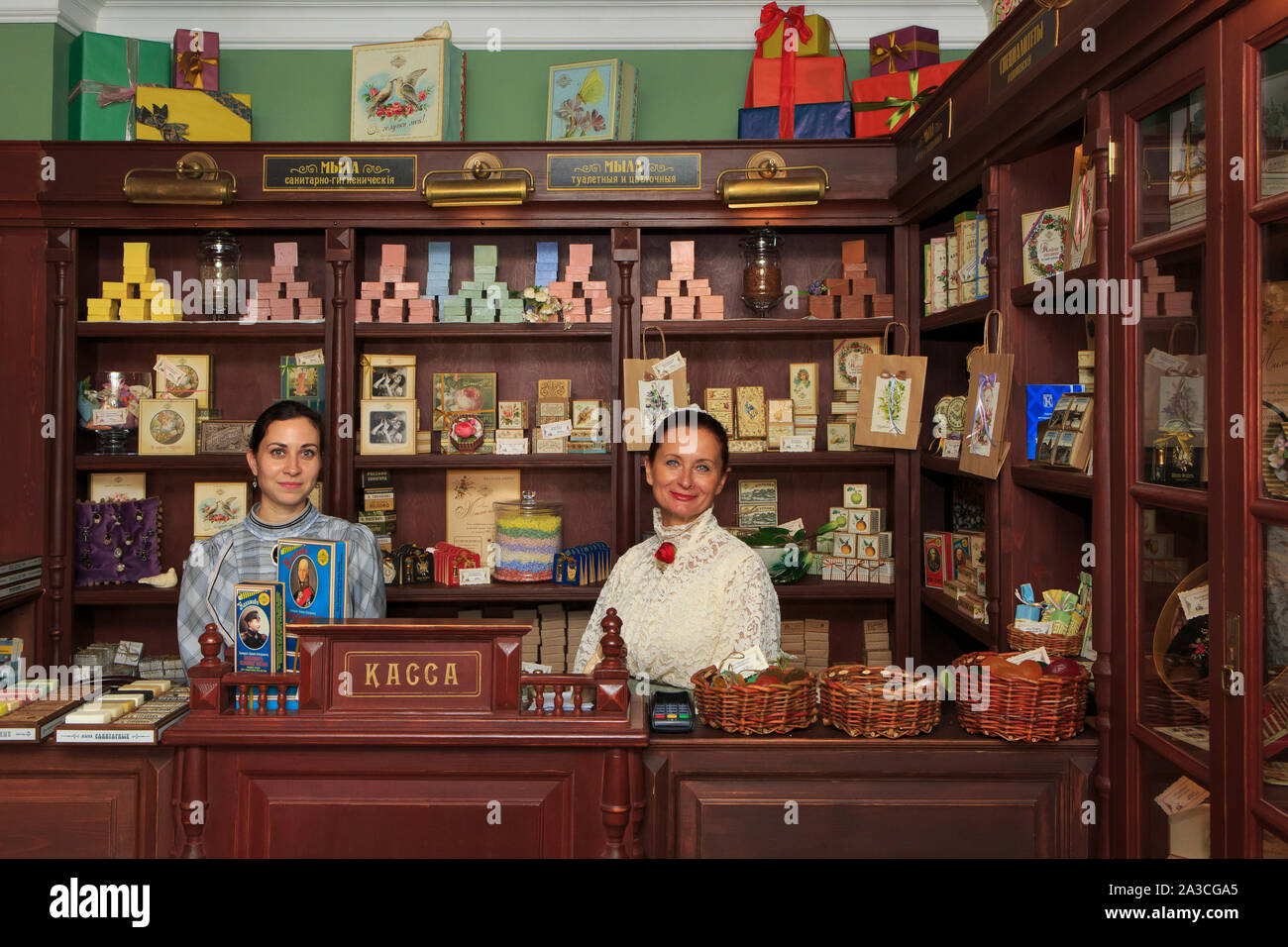 Two lovely ladies in traditional attire at the shop of the Museum of the Manufacturing of Fragrant Joys (soaps and soap products) in Kolomna, Russia Stock Photo