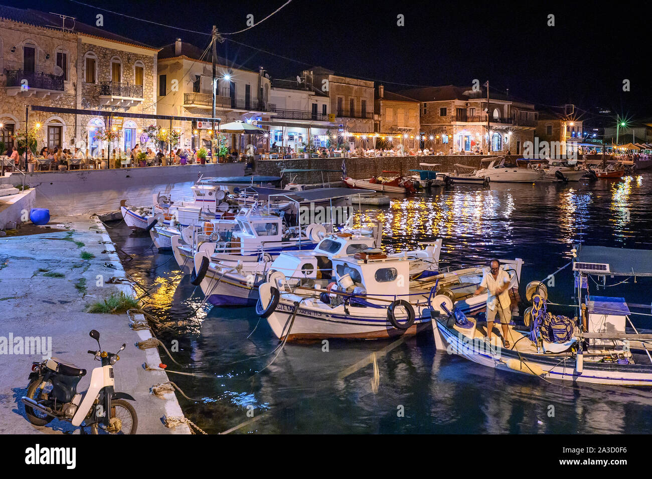 Looking across the harbour in the little fishing village of Ayios Nikolaos on a summer night.  In The Outer Mani, Southern Peloponnese, Greece. Stock Photo