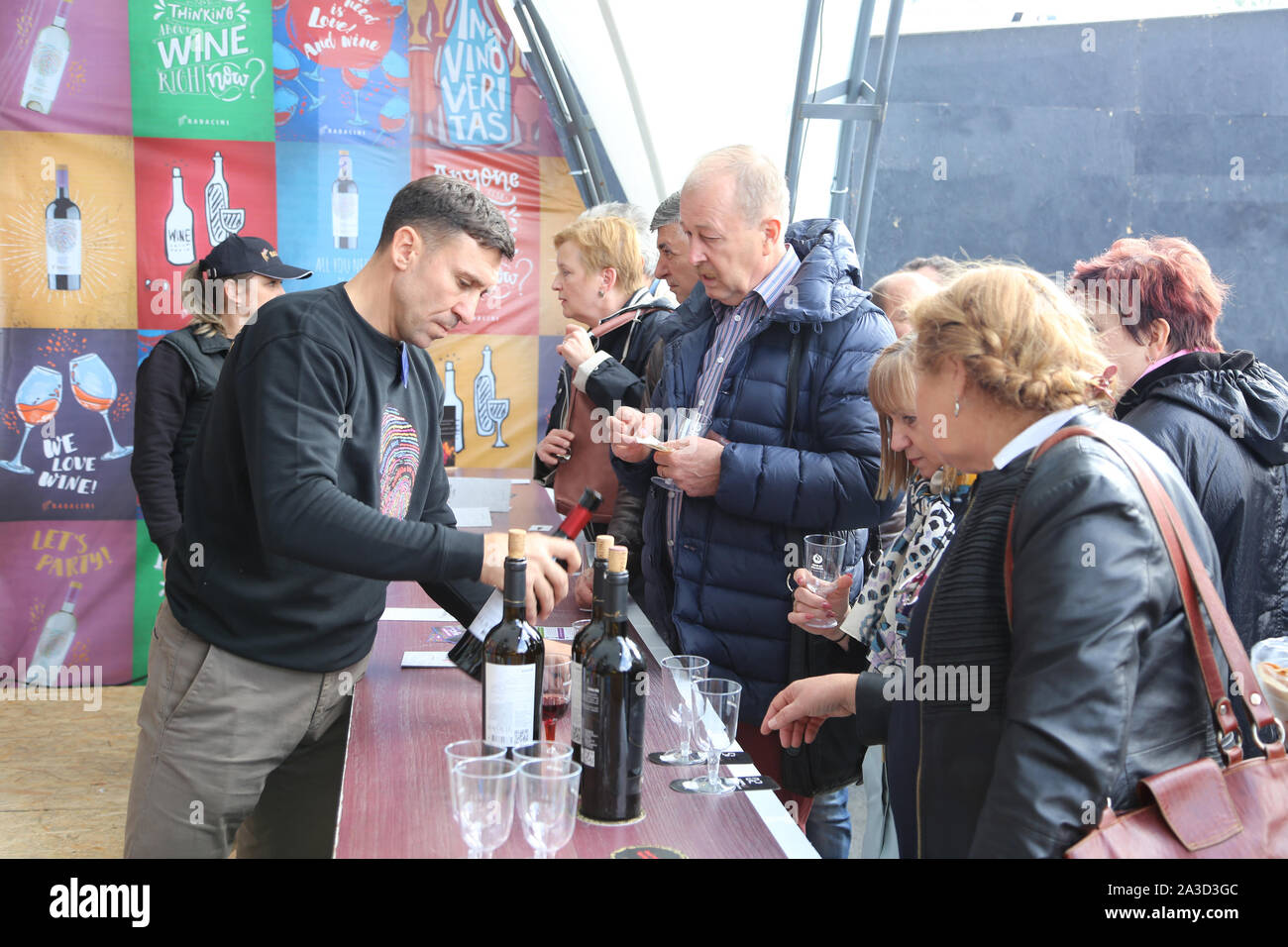 Chisinau, Moldova. 5th Oct, 2019. People take part in an event during the 18th edition of the National Wine Day in Chisinau, Moldova, Oct. 5, 2019. Moldova's two-day National Wine Day, aiming to promote wine production and exports, ended here on Sunday. Credit: Chen Jin/Xinhua/Alamy Live News Stock Photo