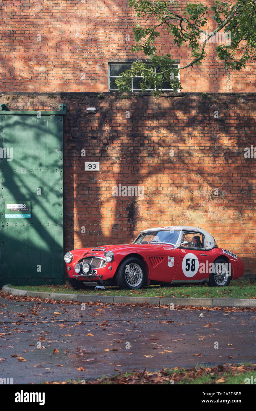 1962 Austin Healey car at Bicester heritage centre autumn sunday scramble event. Bicester, Oxfordshire, UK. Vintage filter applied Stock Photo
