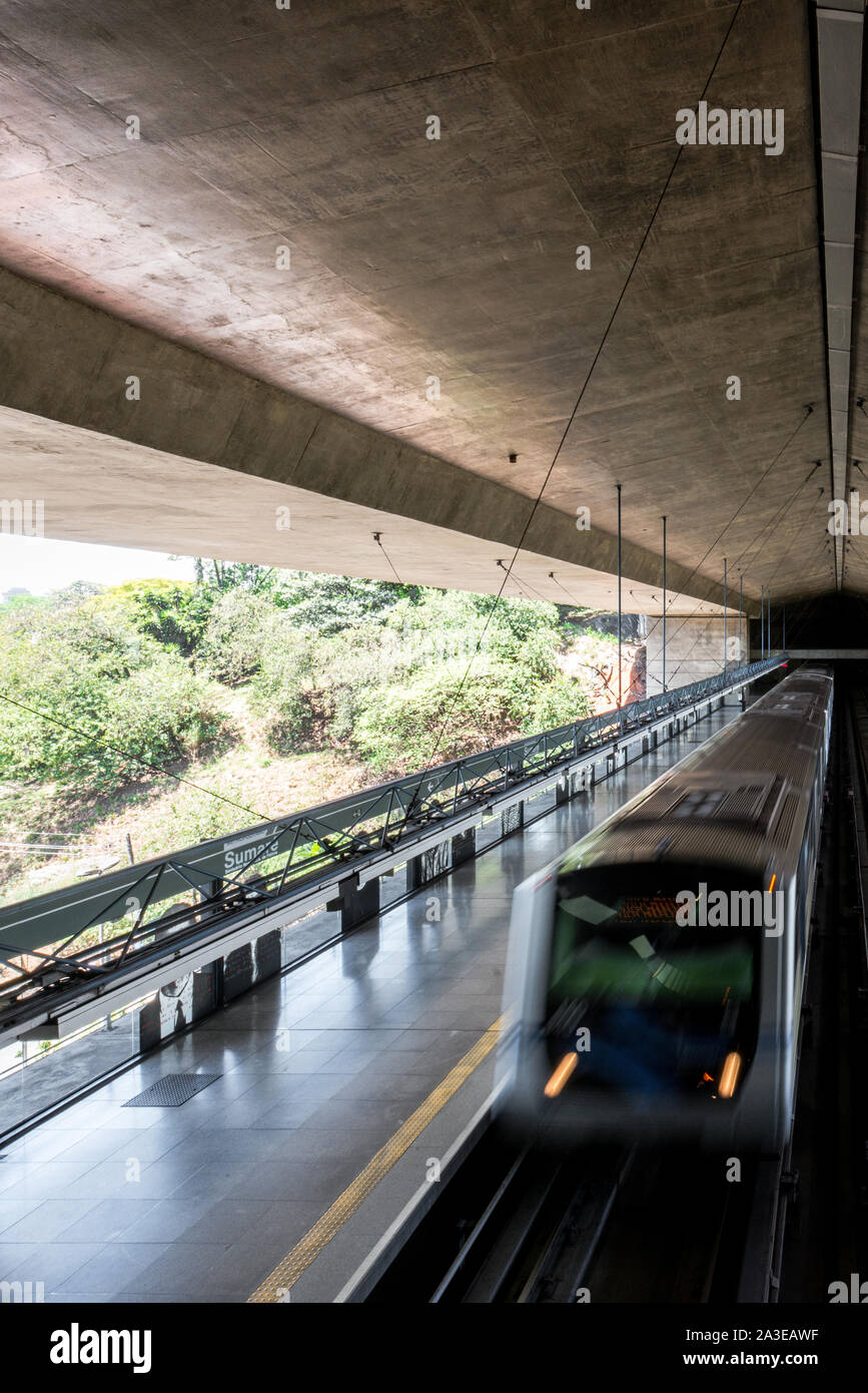 SAO PAULO, BRAZIL - 05, OCTOBER, 2019: Vertical picture of moving train at Sumare Metro Station, located in Sao Paulo, Brazil Stock Photo