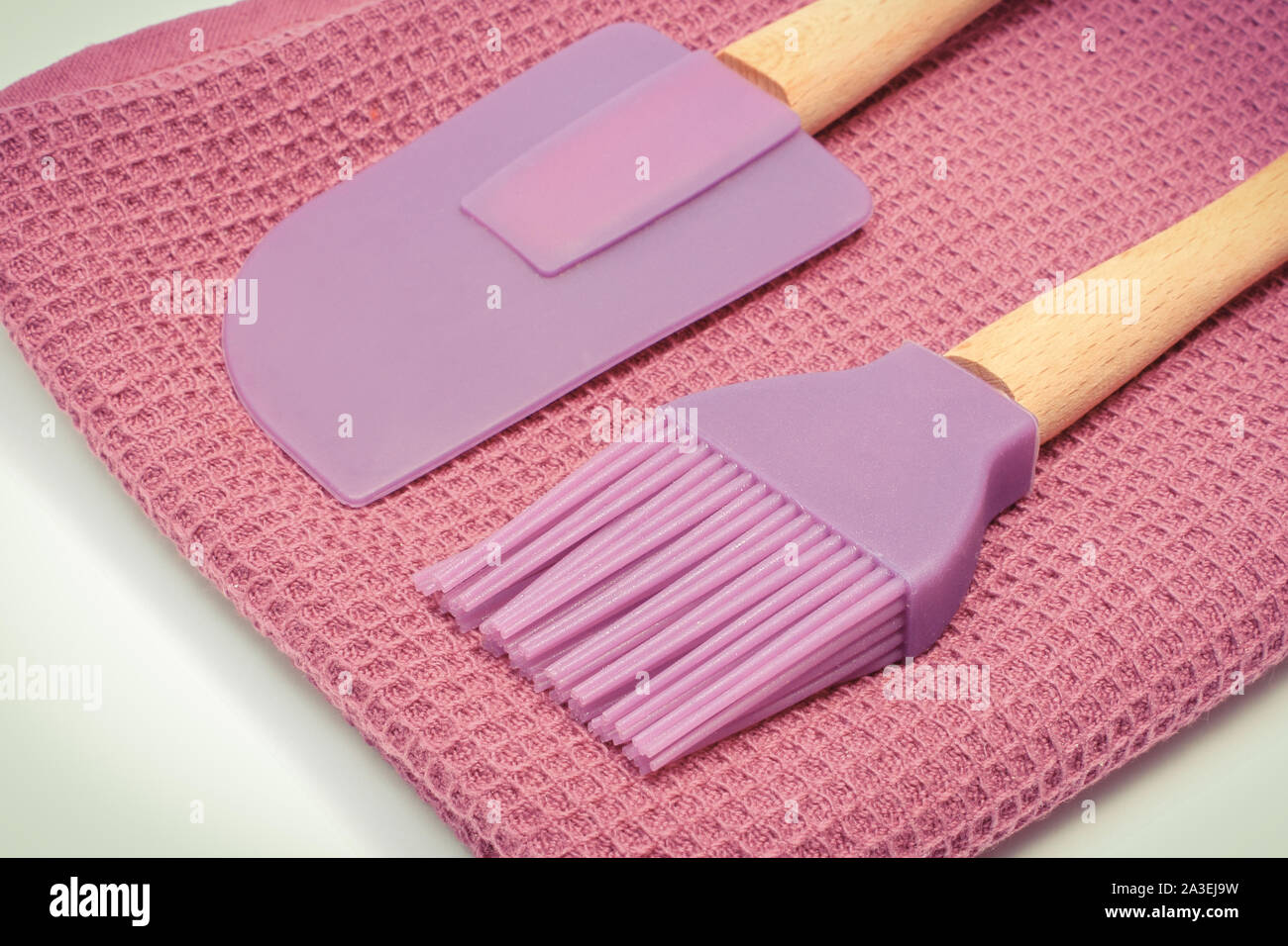 Closeup of silicone kitchen accessories, spatula and brush ...