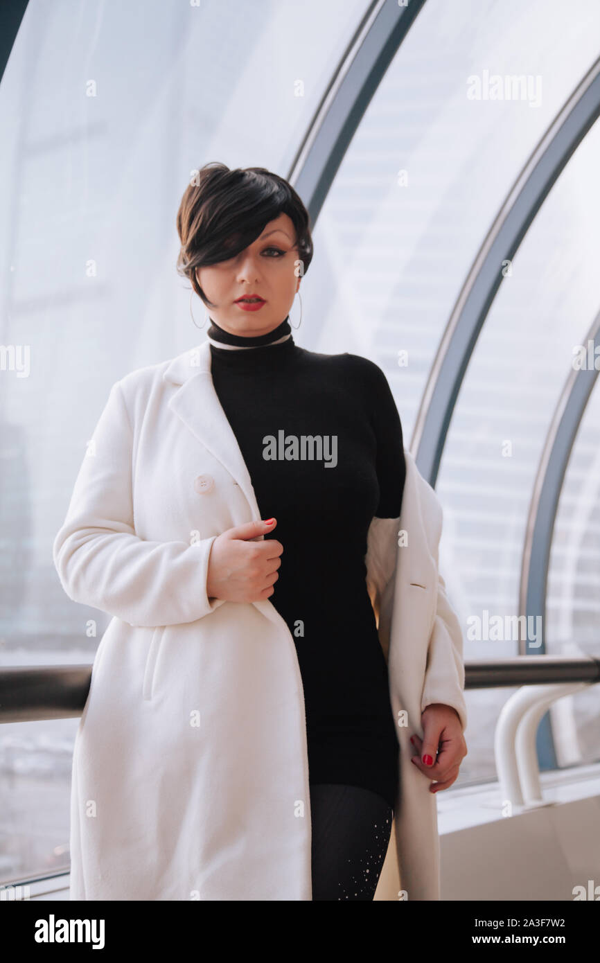 Young Beautiful Stylish Woman In White Wool Coat Walking Down The Street Plus Size Short Hair Adult Girl Posing Alone Stock Photo Alamy