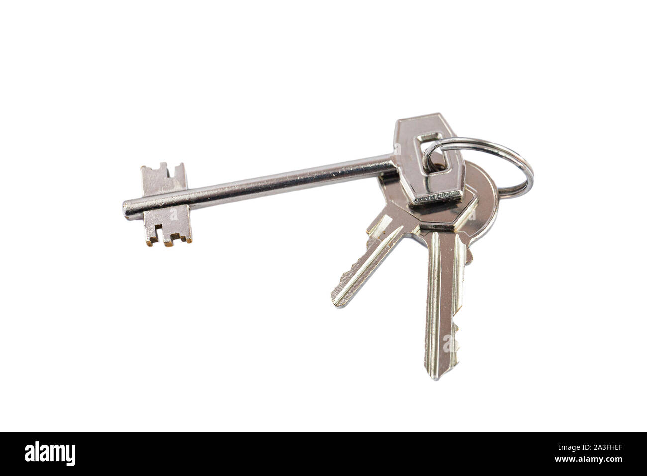 Bunch of keys with metal ring on white background Stock Photo