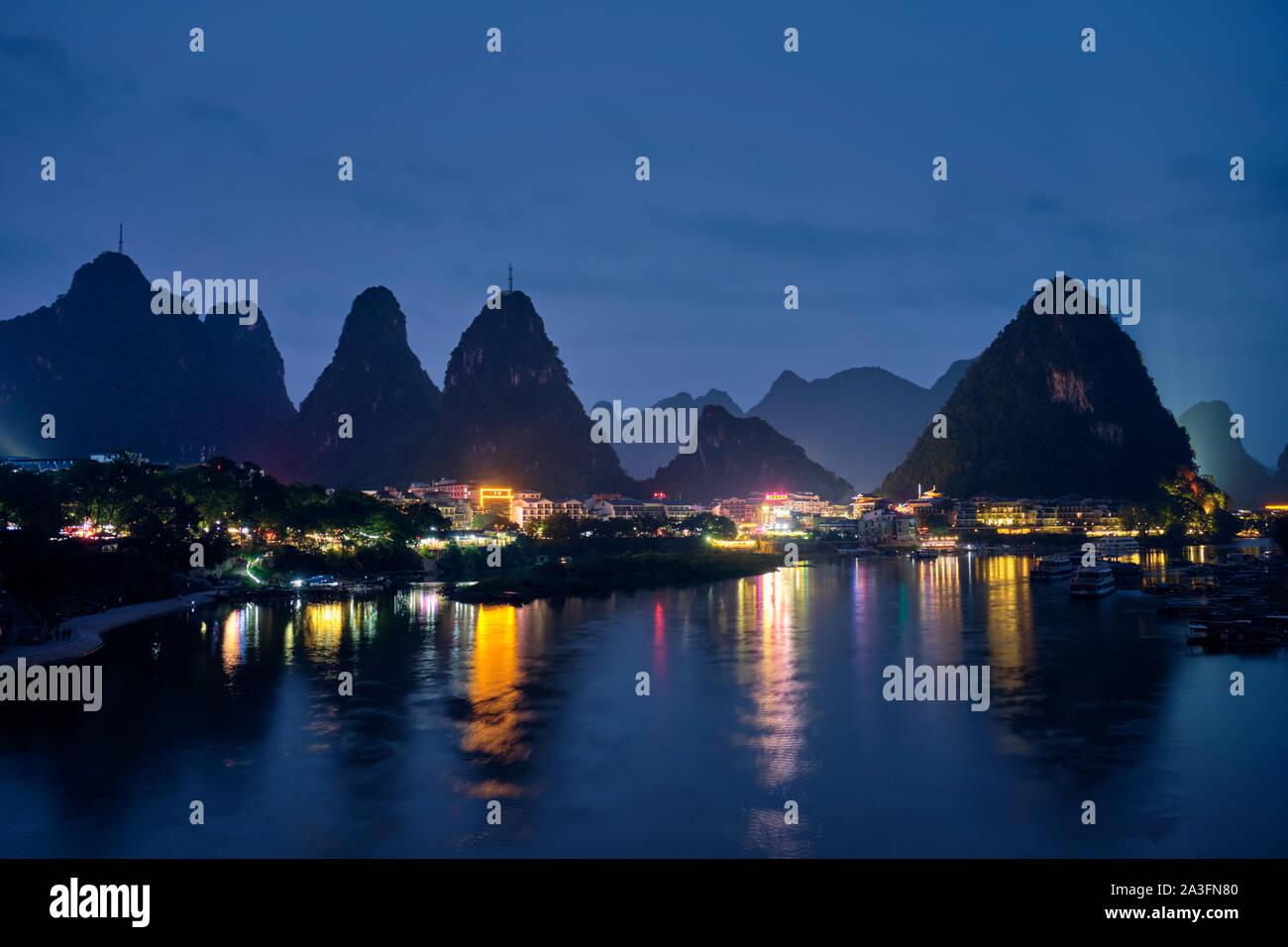 Yangshuo town illuminated in the evening, China Stock Photo