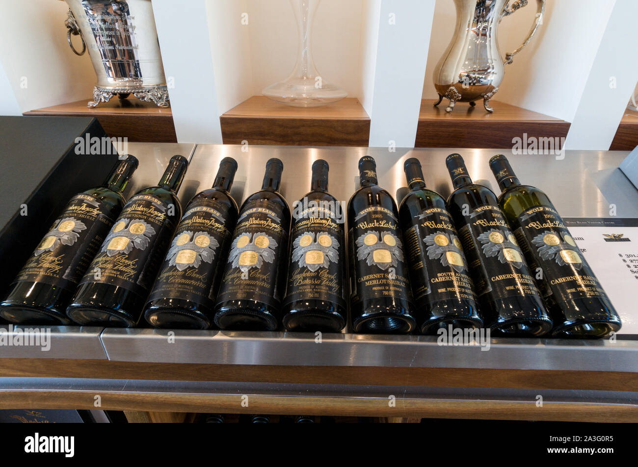 A row of prestige wines from 1973 to 1995 on sale at the Wolf Blass winery visitors centre in the Barossa Valley wine region in South Australia.   The Stock Photo