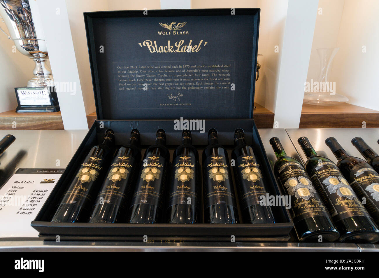 A case of six bottles of Wolf Blass Black Label Museum Collection from each year 2000-2005 with a price tag of Aus $ 678.00, on sale at the Wolf Blass Stock Photo