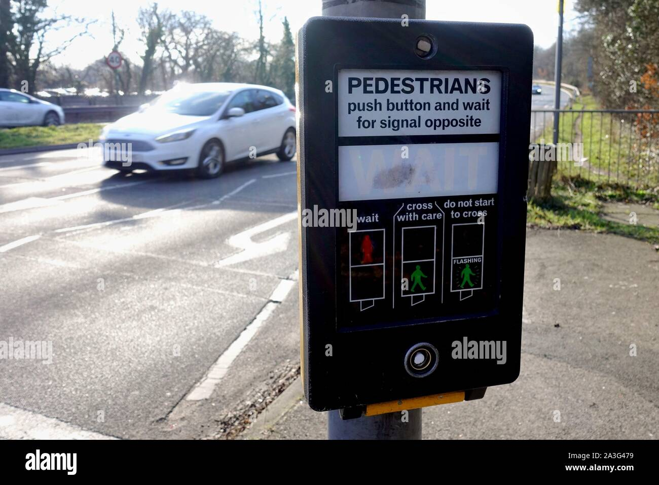 Camberley, Surrey, UK - February 6 2018: Pedestrian crossing button and control display, where people can push a button to change the traffic lights, Stock Photo