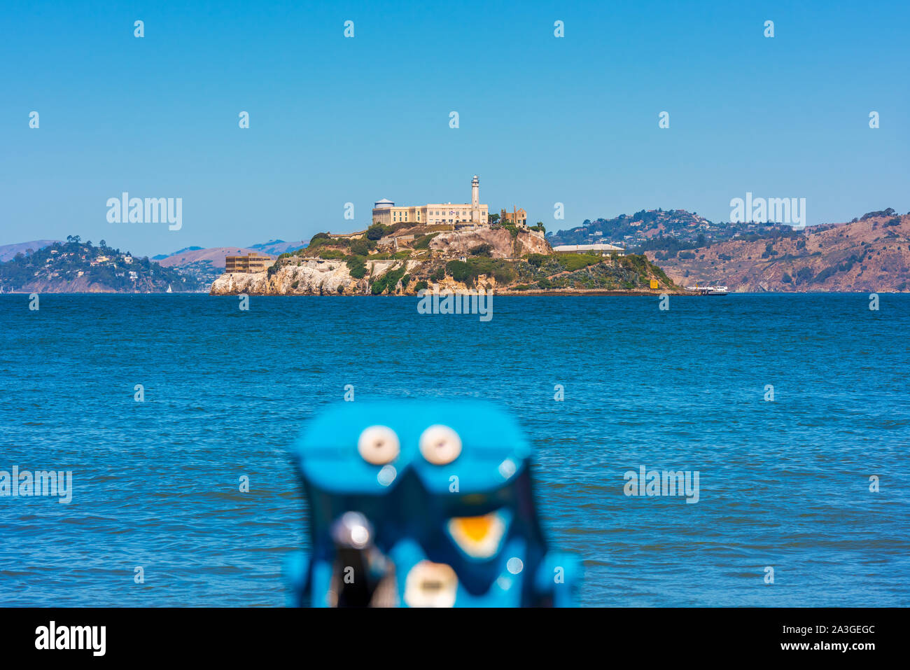Alcatraz Island and former prison in San Francisco Bay, California, USA. Out of focus binoculars on foreground. Stock Photo