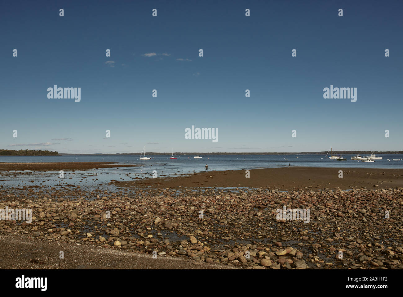 A cool Fall day in Lincolnville Beach off the coast of Penobscot Bay in Lincolnville, Maine. Stock Photo
