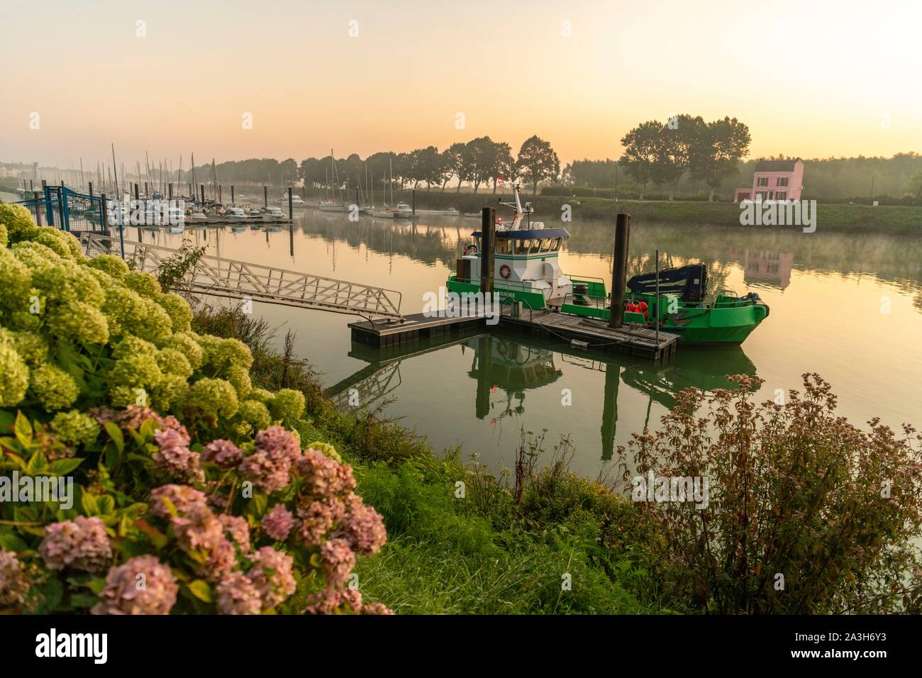 France, Somme, Somme Bay, Saint Valery sur Somme, the buoyage in the port of Saint Valery, it is the boat which maintains the channel of access to the port and fight against the silting Stock Photo