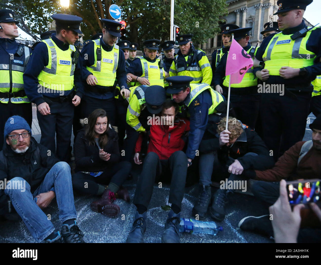 08/10/2019 Budget Day 2020 protests. Pictured, members of An Garda Siochana begin to arrest members of Extinction Rebellion who are protesting outside the Dail on Leinster Street. Photograph: Sam Boal / RollingNews.ie Stock Photo